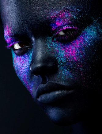 Close up shot of a black woman face with neon make up
